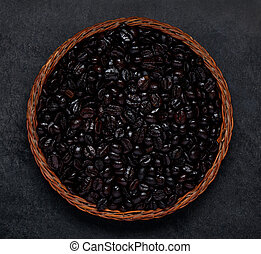 Black Roasted Coffee Beans on Dark Background