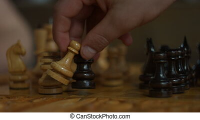 Black rook capturing white pawn in chess game - Closeup of...