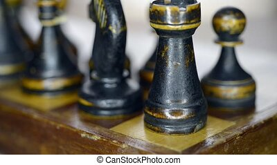 black rook corner - vintage chess set up on chessboard with...