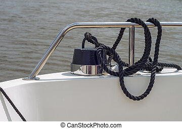 Black Rope Tied To Weight On Boat