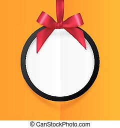 Black round hanging frame with red silky bow and ribbon on orange background