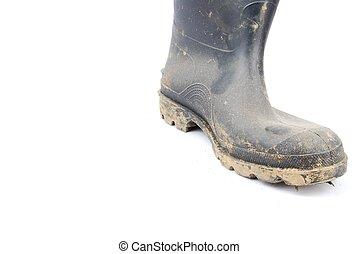 Black rubber boot on white