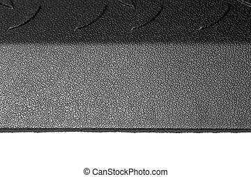 Black Rubber mat half lighted.