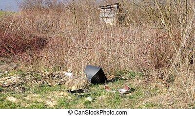 Black rubbish dump in the village