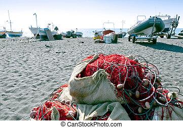 Black sand beach and fishing equipment
