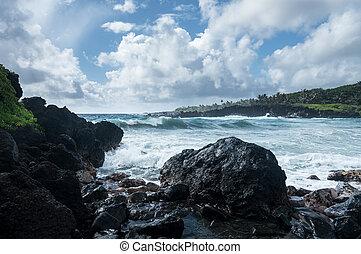 Black sand beach at Waianapanapa on the road to Hana in Maui