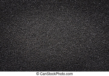 Black sand. Texture and background, light center for copy space