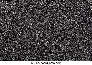 Black sand. Texture and background