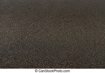 Black sand volcanic beach background in Bali, Indonesia....