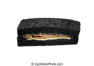 Black sandwich with ham and cheese.