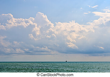 Black sea on the background of clouds.