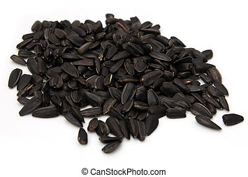 black seeds on a white background