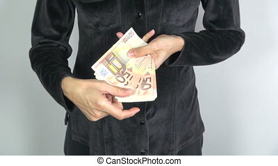 black shirt woman offering banknote