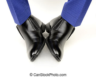 black shoes on the feet of a man