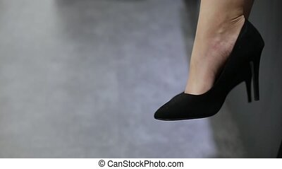 Black shoes on woman's legs close up