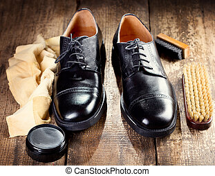 black shoes with care accessories