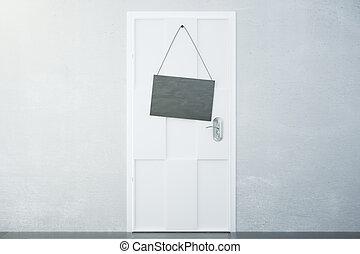 Black signboard on white door in empty room, mock up