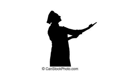 Black silhouette of a chef female gesticulating praising her dishes.