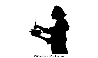 Black silhouette of a cook lady in uniform trying dish. -...