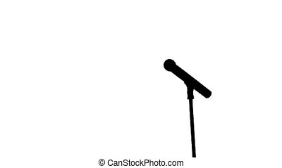 Black silhouette of a microphone and coming to it singer on a white background