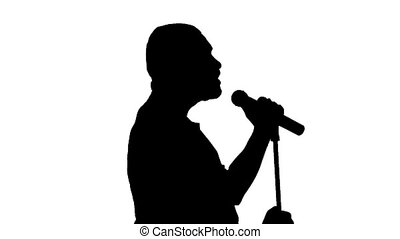 Black silhouette of a singer vigorously singing on a white background