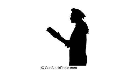 Black silhouette of chef lady with long hair reading...
