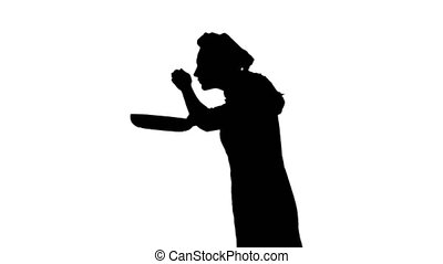 Black silhouette of cook woman is frying and sniffing dish....
