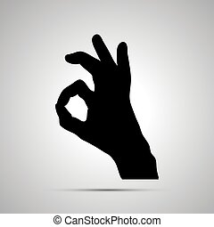 Black silhouette of hand in OK gesture on white