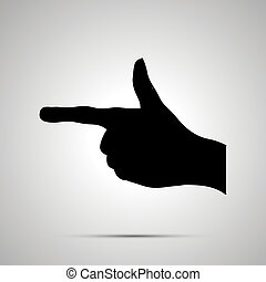 Black silhouette of hand in pointing gesture on white