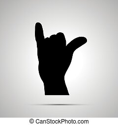 Black silhouette of hand in shaka gesture on white