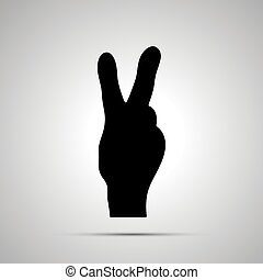 Black silhouette of hand in victory gesture on white
