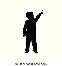 Black silhouette of little boy pointing to sky. Kid in winter clothes