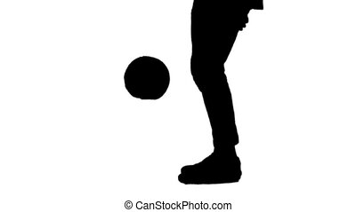 Black silhouette of man stuffing soccer ball on his leg.
