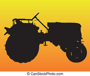 black silhouette of the wheel of the tractor