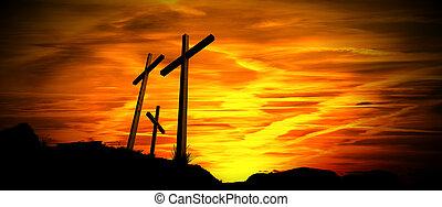 Black Silhouette of Three Crosses at Sunset