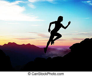 Black silhouette of woman jumps up on the rock.
