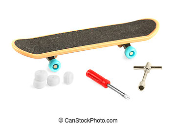 Black skateboard with yellow edge and blue wheel near tools...