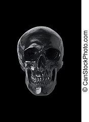 Black skull isolated on black background