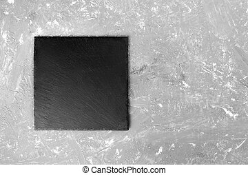 black slate plate for serving with copy space, top view