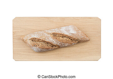 Black small bread on wooden board