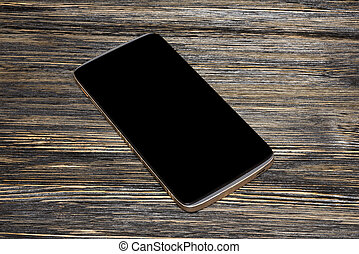 black smart phone with isolated screen on old wooden desk