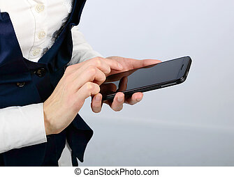 Black smartphone in the hands