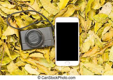 black smartphone screen on neem leaves. mockup template....
