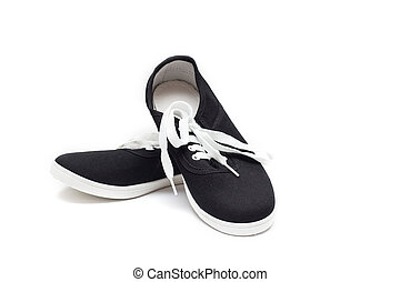 Black sneakers with white laces on a white background