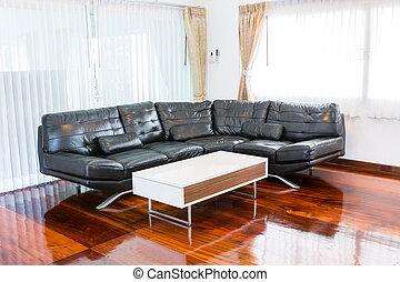 Black sofa in room