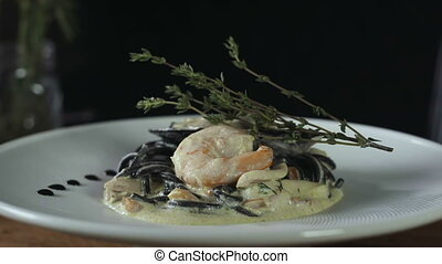 Black Spaghetti With Prawns on White Plate Complete