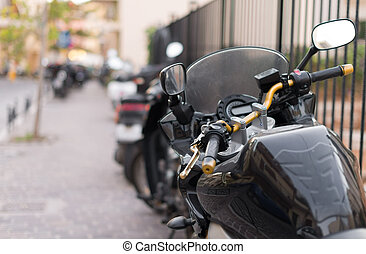Black sport motorcycle parked on the parking lot.