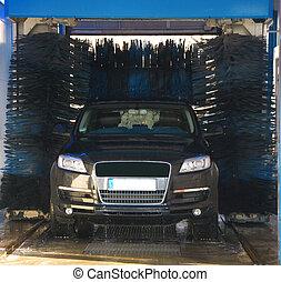 car wash - black sports car in a car wash