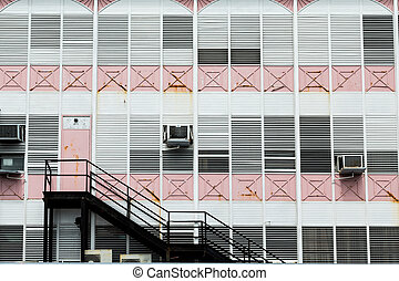 Black Stairs on Old Pink and White Building