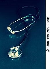 Black stethoscope in the dark